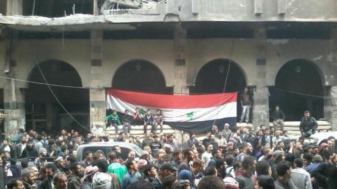 Người dân thượng cở trong thành phố Douma . ảnh minh họa Masdar News