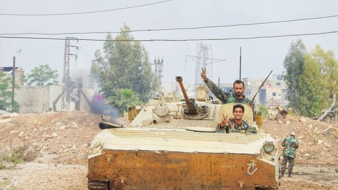 Các đơn vị Vệ binh Cộng hòa tiến công trên quận Al-Qadam, ngoại ô phía nam Damasscus. Ảnh truyền thông Al-Masdar News