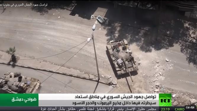 Quân đội Syria, Plesstine tấn công quận Hajar Al-Aswad.Ảnh RT