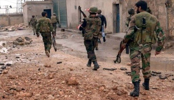 Binh sĩ quân đội Syria ở Rastan tỉnh Homs, ảnh minh họa Masdar News