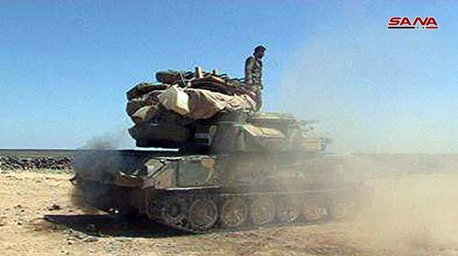 Các đơn vị vũ trang Syria tiến công Sweida. Ảnh hãng tin SANA