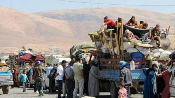 Những người dân di tản Syria trở về từ các nước láng giềng lân cận. Ảnh minh họa Masdar News