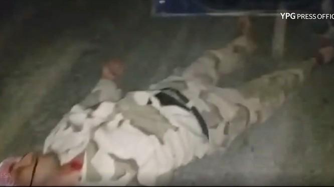 Lực lượng dân quân người Kurd ám sát chiến binh FSA. Ảnh minh họa video Masdar News