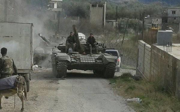 Quân đội Syria trên chiến trường vùng nông thôn Latakia. Ảnh minh họa Masdar News