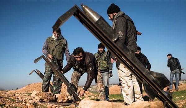 Nhóm chiến binh Hồi giáo thánh chiến chuẩn bị tên lửa tự chế tấn công chiến tuyến quân đội Syria. Ảnh minh họa Muraselon