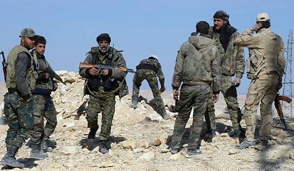 Lực lượng vũ trang địa phương NDF trên chiến trường Lattakia. Syria. Ảnh minh họa: Masdar News.