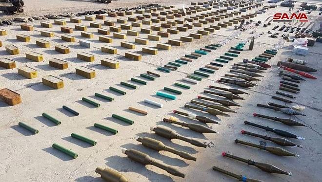 Vũ khí thu được trên địa phận tỉnh Homs. Ảnh SANA