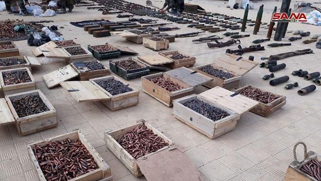 Kho vũ khí khổng lồ của FSA ở thị trấn Barzeh bị quân đội Syria thu giữ. Ảnh minh họa video SANA