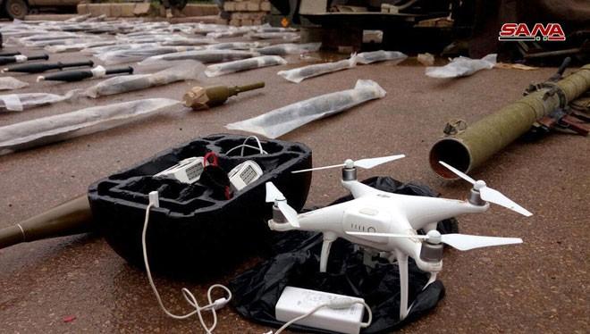 Vũ khí và máy bay trinh sát không người lái UAV, được thu giữ tại Daraa. Ảnh: SANA.