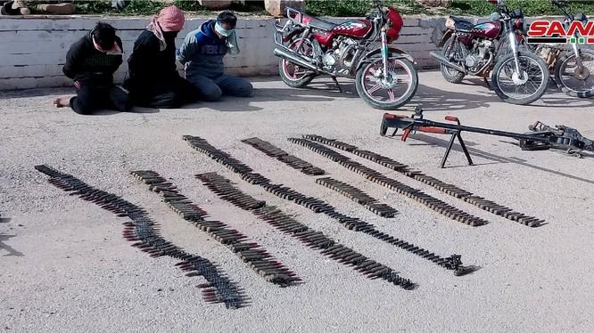 Quân đội Syria tiêu diệt và bắt giữ khủng bố IS, thu chiến lợi phẩm. Ảnh minh họa: SANA.