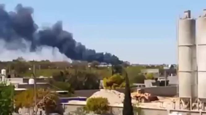 Không quân NLA không kích phá hủy kho vũ khí đạn của GNA gần thị trấn Wadi al-Ra'bi. Ảnh South Front