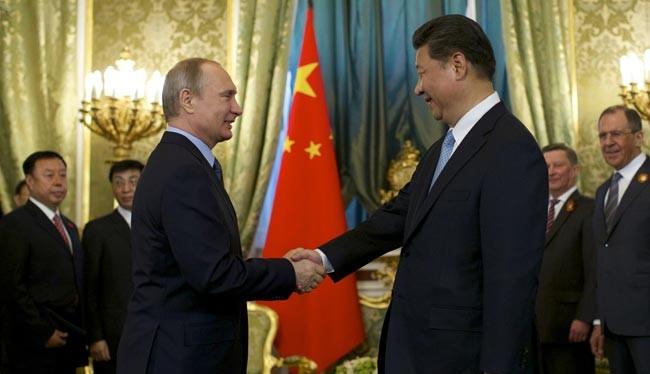Tổng thống Nga Vladimir Putin (phải) và người đồng cấp Trung Quốc (ảnh tư liệu)