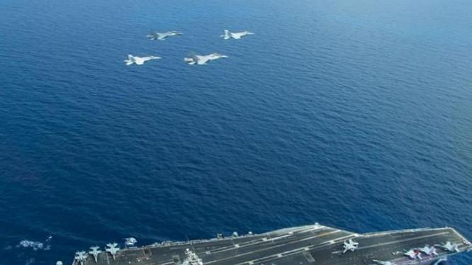 Cụm tấn công tàu sân bay USS Carl Vinson trên Biển Đông. Ảnh: AFP/News.com.au