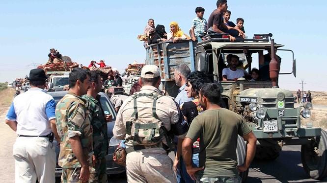 Người dân ở Daraa trở về nhà sau khi quân đội Syria đánh bại IS