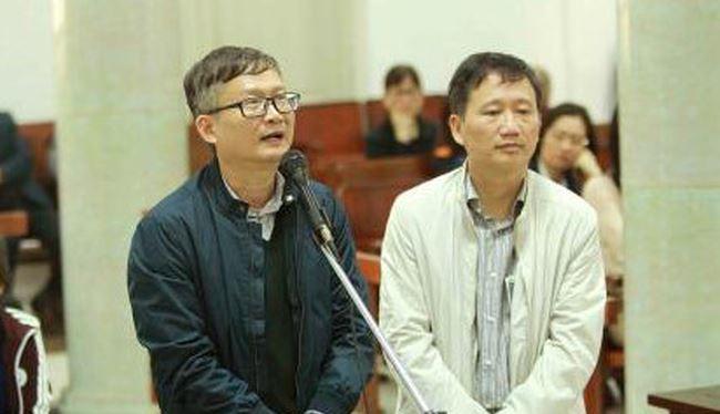 Bị cáo Đinh Mạnh Thắng và bị cáo Trịnh Xuân Thanh tại tòa. Ảnh: TTXVN