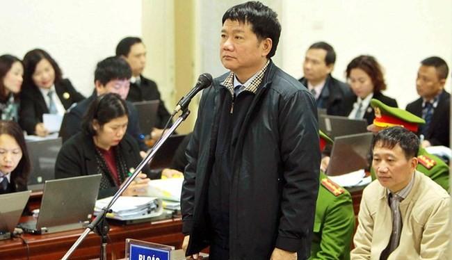 Ông Đinh La Thăng, ông Trịnh Xuân Thanh tại phiên tòa sơ thẩm. Ảnh: TTXVN