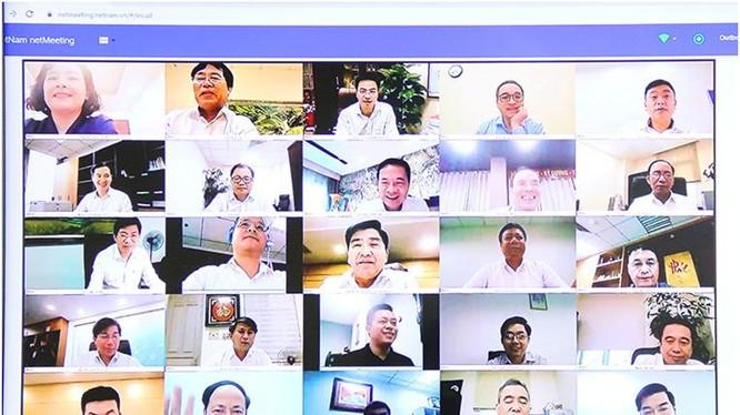 Bộ trưởng Nguyễn Mạnh Hùng chủ trì giao ban trực tuyến .Ảnh Mic