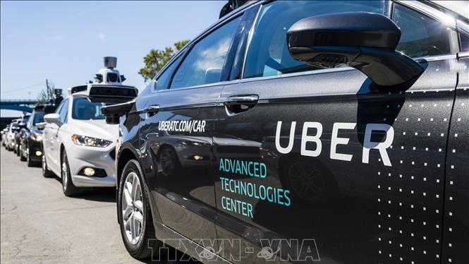 """Dịch vụ đi xe chung Uber của Mỹ đang đặt mục tiêu vươn xa hơn và trở thành """"Amazon của ngành giao thông vận tải"""". Ảnh minh họa: AFP/TTXVN"""
