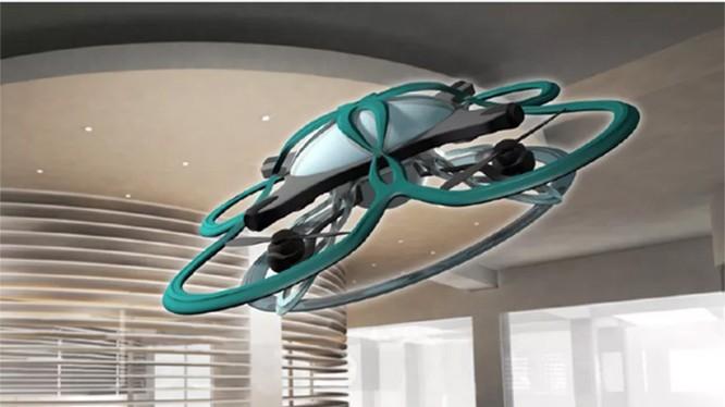 """Những nhân viên làm việc quá giờ sẽ bị drone đến """"hỏi thăm"""" (ảnh: The Verge)"""