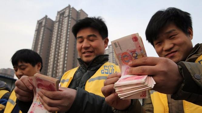 Tiền mặt ngày càng vắng bóng trong các hoạt động thương mại tại Trung Quốc (ảnh: Getty Images)