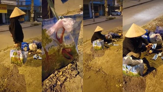 Người phụ nữ ngồi cắt khẩu trang đã sử dụng trong các đống rác