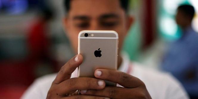 Ẩn sau mã độc hack iPhone từ xa là một tổ chức cực kỳ bí ẩn- ẢNH: AFP