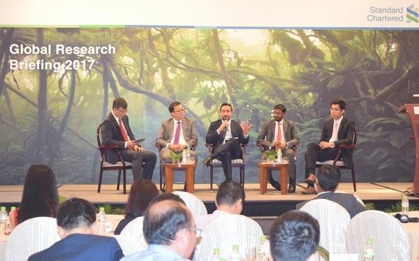 Buổi thuyết trình kinh tế toàn cầu do Standard Chartered tổ chức ngày 13-1 tại TPHCM. Ảnh: TL