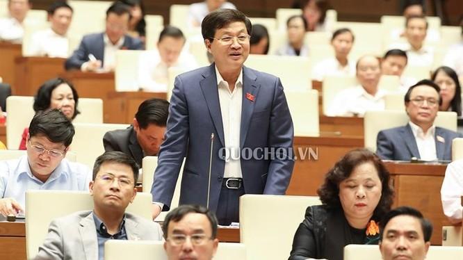 Tổng Thanh tra Chính phủ Lê Minh Khái trả lời chất vấn của đại biểu Quốc hội sáng 30/10. (Ảnh: Quochoi.vn)