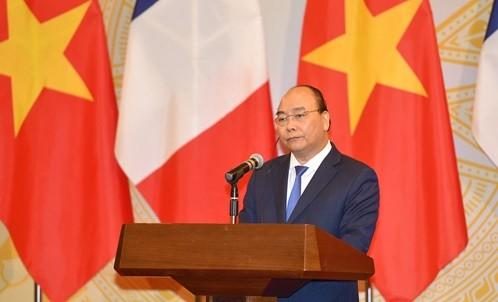 Thủ tướng Nguyễn Xuân Phúc phát biểu tại họp báo. Ảnh: VGP/Quang Hiếu