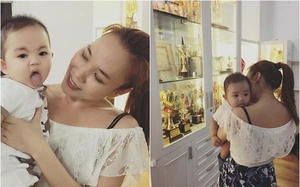 """Hình ảnh Mỹ Tâm """"cưng nựng"""" Kubi (con trai Khánh Thi) khiến nhiều người tin rằng nữ ca sĩ cũng khát khao được làm mẹ."""