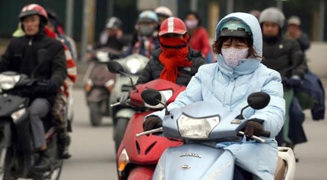 Hà Nội và các tỉnh Bắc, Trung Bộ đang trong đợt rét hại, nhiệt độ phổ biến 8-11 độ C. Ảnh: TTXVN