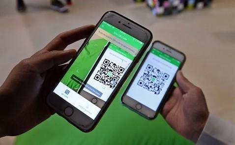 Grab vừa thêm tính năng cho phép người dùng thanh toán hóa đơn tại các cửa hàng bằng cách scan mã QR từ ví điện tử GrabPay by Moca.
