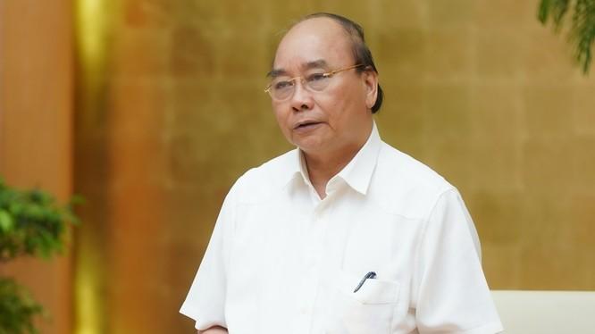 Thủ tướng Nguyễn Xuân Phúc đề nghị xác lập tình trạng bình thường mới trong cuộc sống và các hoạt động kinh tế - xã hội. Ảnh: VGP