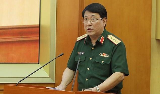 Đại tướng Lương Cường trình bày báo cáo tại hội nghị.
