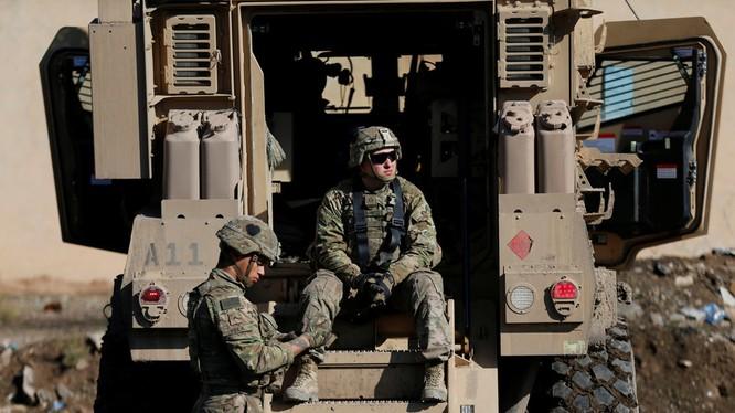 Theo giới phân tích, việc loại bỏ sự hiện diện của quân đội Mỹ ở Iraq không chỉ cần một nghị quyết là xong (Ảnh: RT)