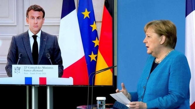 Tổng thống Pháp Emmanuel Macron và Thủ tướng Đức Angela Merkel kêu gọi lời giải thích về vụ bê bối do thám (Ảnh: AFP)