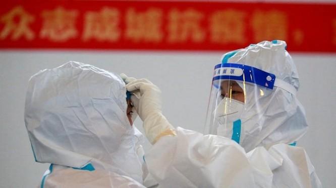 Các nhà khoa học Trung Quốc cho rằng COVID-19 xuất hiện ở Mỹ trước đợt dịch ở Vũ Hán (Ảnh: AFP)