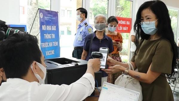 Bộ Công an đang triển khai thí điểm Hệ thống quản lý tiêm chủng vaccine. Ảnh: VGP