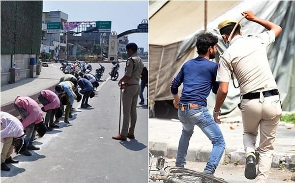 Cảnh sát Ấn Độ trừng phạt người không đeo khẩu trang bằng... roi, gậy.