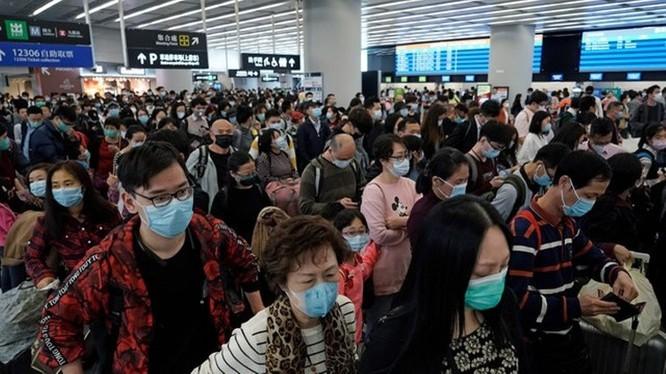 Hành khách tại sân bay ở Trung Quốc. Ảnh: The Straitimes