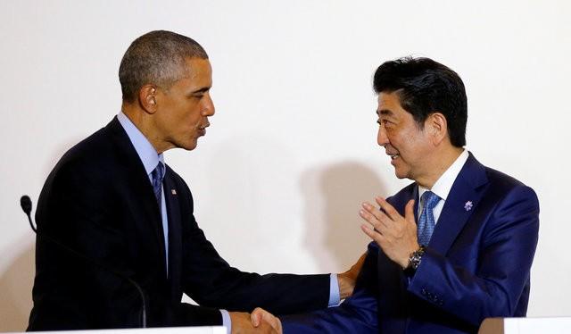 Tổng thống Mỹ Barack Obama và Thủ tướng Nhật Bản Shinzo Abe - Ảnh: Reuters