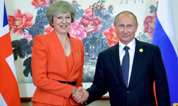 Thủ tướng Anh Theresa May và Tổng thống Nga Putin.