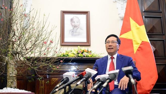 Phó thủ tướng Phạm Bình Minh tại buổi gặp gỡ báo chí đầu năm. Ảnh: Tiến Tuấn.
