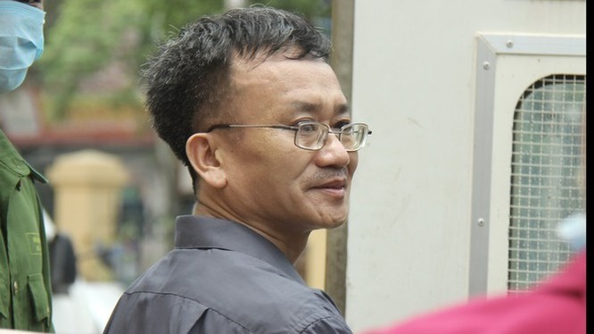 Bị cáo Nguyễn Quang Vinh bị cáo buộc chủ mưu vụ nâng điểm, VKS đề nghị mức án 7 đến 8 năm tù. Ảnh: Zing