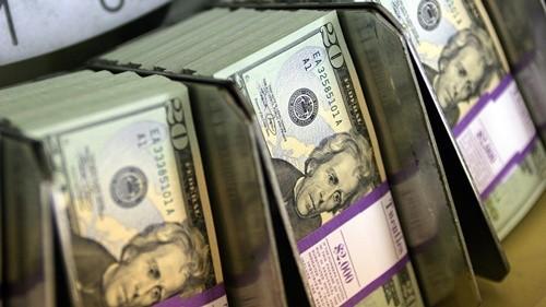 USD đang ở đỉnh 12 năm so với rổ tiền tệ lớn trên thế giới. Ảnh: Bloomberg