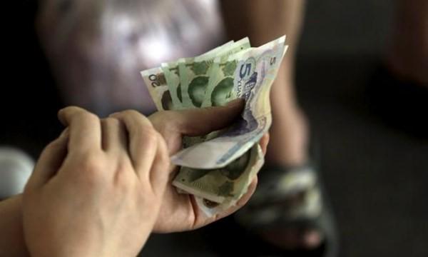 Ngân hàng Trung ương TQ: Không có lý do để giảm đồng NDT nữa!