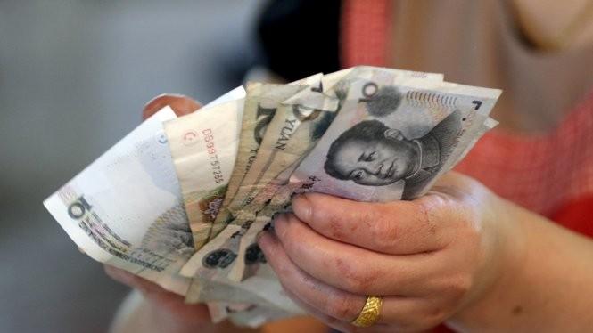 Tỷ giá đồng Nhân dân tệ tiếp tục giảm ngày thứ ba liên tiếp - Ảnh: Reuters