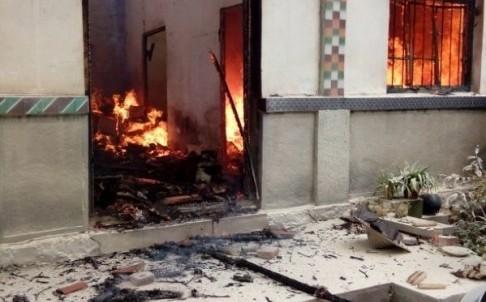 Ngôi nhà bị phóng hỏa. Ảnh: SCMP
