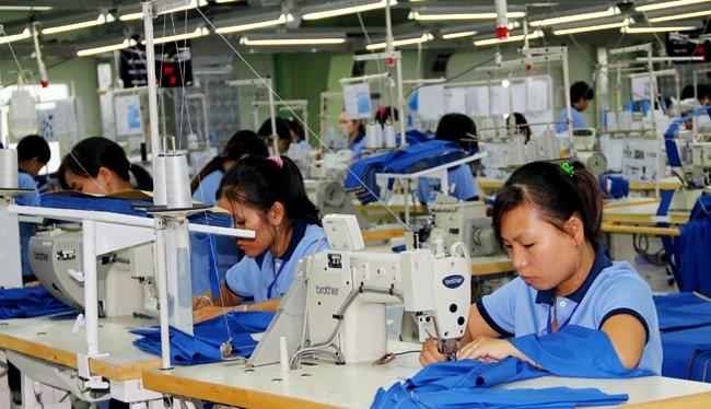 Lao động đang làm việc tại một nhà máy may mặc - Ảnh minh họa: Quốc Hùng