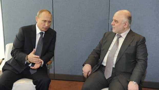 Tổng thống Nga Vladimir Putin trò chuyện với thủ tướng Iraq Haider al-Abadi tại New York trong cuộc họp của Đại hội đồng LHQ tháng 9 vừa qua - Ảnh: Reuters